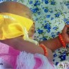 BABY BORN CLUTCHING THE HOLY QUR'AN IN IBADAN