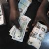 NAIRA APPRECIATES, CLOSES AT N215 TO DOLLAR