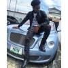 Korede Bello Takes Selfie on 'Mavin' Plated Bentley