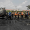 PHOTOS: FRSC officials clear off wreckage of the tanker that exploded on Lagos-Ibadan expressway