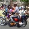 PHOTO OF THE DAY: Man seen carrying 6 children and another man on a bike in Kano